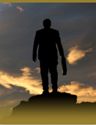 Silhouette of executive against a sunset